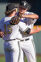 Vanderbilt Commodores pitcher Matt Ruppenthal (28) hugs Carson Fulmer (15) before Game 12 of the NCAA College World Series against the TCU Horned Frogs on June 19, 2015 at TD Ameritrade Park in Omaha, Nebraska. The Commodores defeated TCU 7-1. (Andrew Woolley/Four Seam Images)