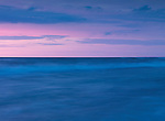 Beautiful light blue and pink sunset scenery of lake Huron in soft pastel colors, Pinery Provincial Park, Grand Bend, Ontario, Canada.