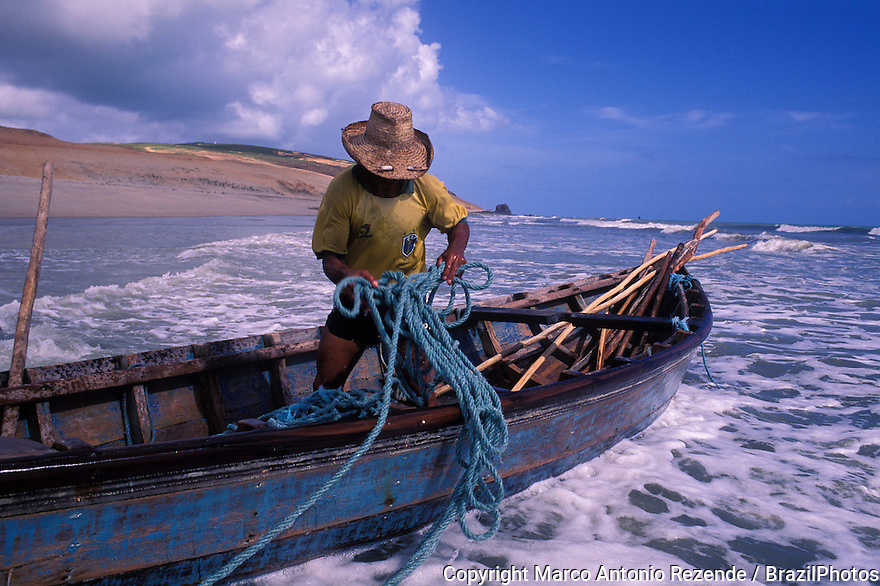 Fisherman, Jericoacoara beach, Ceara State coastline, Northeastern Brazil.