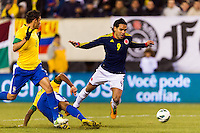 Falcao Garcia (9) of Colombia gets tripped up. Brazil (BRA) and Colombia (COL) played to a 1-1 tie during international friendly at MetLife Stadium in East Rutherford, NJ, on November 14, 2012.