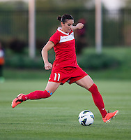 Ali Krieger (11) of the Washington Spirit punts the ball forward during the game at the Maryland SoccerPlex in Boyds, MD.  Washington tied Western NY, 1-1.