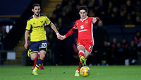 George Williams of MK Dons in possession as Oxford United's Agon Mehmeti looks on during Oxford United vs MK Dons, Sky Bet EFL League 1 Football at the Kassam Stadium on 1st January 2018