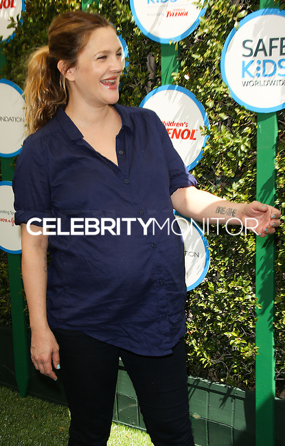 WEST HOLLYWOOD, CA, USA - APRIL 05: Drew Barrymore at the Safe Kids Day Event 2014 -  Los Angeles held at The Lot on April 5, 2014 in West Hollywood, California, United States. (Photo by Celebrity Monitor)
