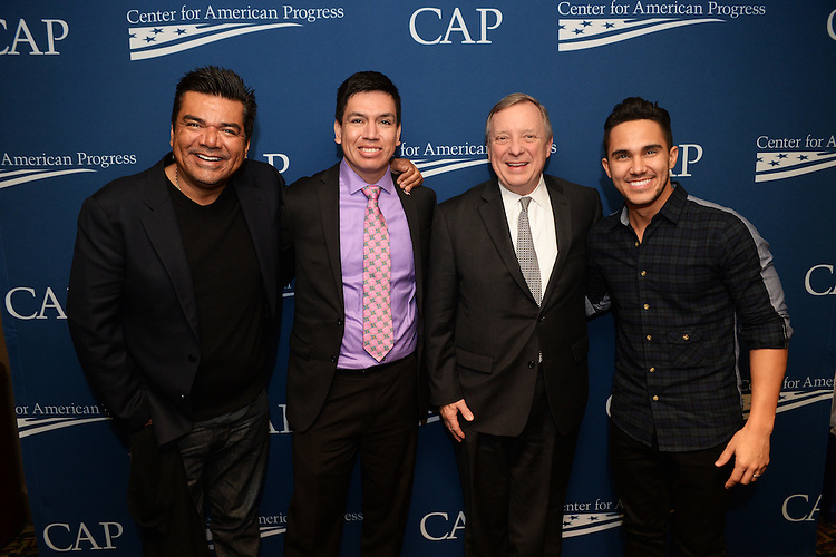 UNITED STATES - JANUARY 13: From left, actor George Lopez, who stars in Spare Parts, Oscar Vazquez, a student from the school who is portrayed by Carlos PenaVega, right, and, Senate Minority Whip Richard Durbin, D-Ill., talk after a screening of the film at the E Street Cinema, January 13, 2015. It is the story of hispanic high school students who prevail in a science competition, despite long odds, against well established universities. The screening was part of the Center for American Progress' Reel Progress film series and Durbin was in attendance because of his sponsorship of the Dream Act.  (Photo By Tom Williams/CQ Roll Call)