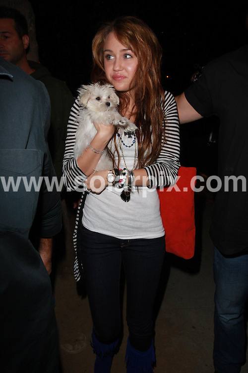 **ALL ROUND PICTURES FROM SOLARPIX.COM**.**WORLDWIDE SYNDICATION RIGHTS**.**NO PUBLICATION IN AUSTRALIA, NEW ZEALAND, DENMARK, GERMANY OR USA**.Miley Cyrus has a night out with her dad, friends and puppy while having milkshakes at Millions of Milkshakes in Hollywood. California, USA. 14th October 2008..This pic: Miley Cyrus..JOB REF: 7598 LAP (JS)      DATE: 14_10_2008.**MUST CREDIT SOLARPIX.COM OR DOUBLE FEE WILL BE CHARGED* *UNDER NO CIRCUMSTANCES IS THIS IMAGE TO BE REPRODUCED FOR ANY ONLINE EDITION WITHOUT PRIOR PERMISSION*
