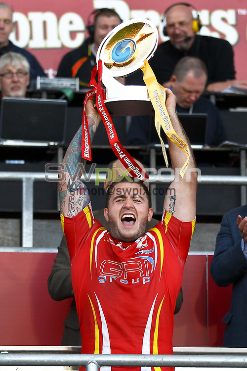 Picture by Alex Whitehead/SWpix.com - 29/09/2013 - Rugby League - Kingstone Press Championships Finals Day - Leigh Sports Village, Leigh, England - Championship Grand Final - Sheffield Eagles v Batley Bulldogs - Sheffield captain Mitchell Stringer lifts the trophy.