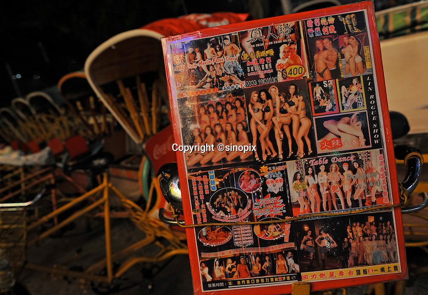 "Rickshaw riders advertise sex shows in Macau, 25th October 2008.  Macau is known simply as ""Vegas"" in China. The former Potuguese colony, now a Chinese Special Administrative Region, attracts millions of Chinese gamblers annually and last year earned more gambling dollars than Las Vegas."
