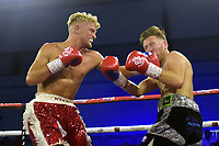 Jonny Phillips (red shorts) defeats Jamie Speight during a Boxing Show at Bracknell Leisure Centre on 8th July 2018