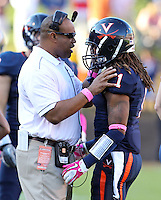 Oct. 22, 2011 - Charlottesville, Virginia - USA; Virginia Cavaliers head coach Mike London has words with Virginia Cavaliers cornerback Demetrious Nicholson (1) during an NCAA football game at the Scott Stadium. NC State defeated Virginia 28-14. (Credit Image: © Andrew Shurtleff
