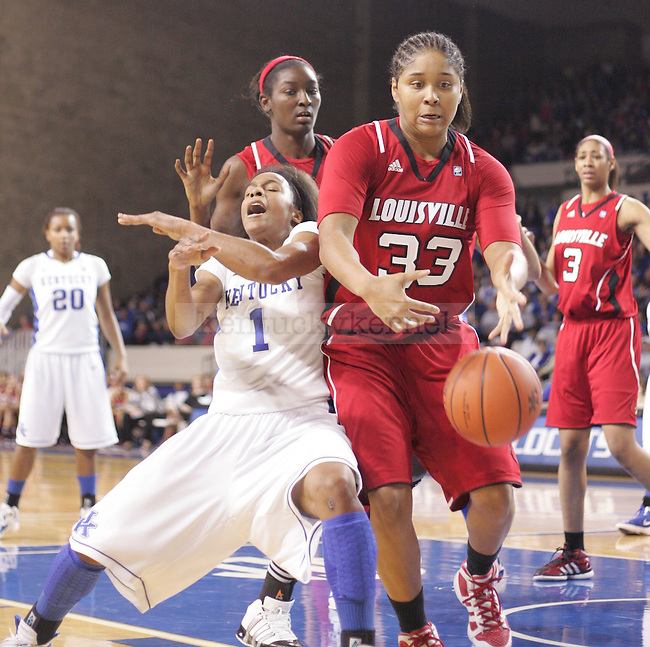 UK junior guard A'dia Mathies is fouled during the first half of the UK Women's basketball game against Louisville on 12/4/11 in Lexington, Ky. Photo by Quianna Lige | Staff