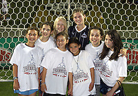 Jill Gilbeau #3 of the Washington Freedom with young fans during a WPS match against the Chicago Red Stars at the Maryland Soccerplex, in Boyds Maryland on June 12 2010. The game ended in a 2-2 tie.