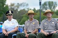 September 26, 2011  (Washington, DC)    The National Park Service held a press conference on the Mall to discuss the damage that occurred to the Washington Monument during last month's earthquake and plans to repair the damage.  A specialized repelling and engineering team will make repairs to the outside surface. (L-R) Captain Harasek, U.S. Park Police; Stephen Lorenzetti, NPS Deputy Superintendent for Planning; and Bob Vogel, Superintendent of the National Mall and Memorials.  (Photo by Don Baxter/Media Images International)