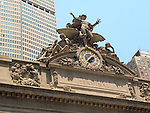 Sculpture and clock on the facade of Grand Central Station in New York City.