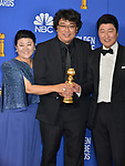 Lee Jeong-eun, Bong Joon-ho, Song Kang-ho 118 poses in the press room with awards at the 77th Annual Golden Globe Awards at The Beverly Hilton Hotel on January 05, 2020 in Beverly Hills, California.