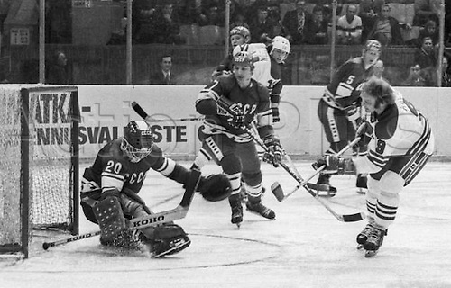 Unknown date. Moscow, Russia. Soviet goalkeeper Vladislav Tretyak (L), Gennady Tsygankov (C), Canada's Bobby Hull (R) seen in action during the match between USSR team and Canada team Winnipeg Jets USSR defeated Canada in Moscow.