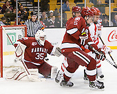 Ryan Carroll (Harvard - 35), Dan Ford (Harvard - 5), Charlie Coyle (BU - 3) - The Harvard University Crimson defeated the Boston University Terriers 5-4 in the 2011 Beanpot consolation game on Monday, February 14, 2011, at TD Garden in Boston, Massachusetts.