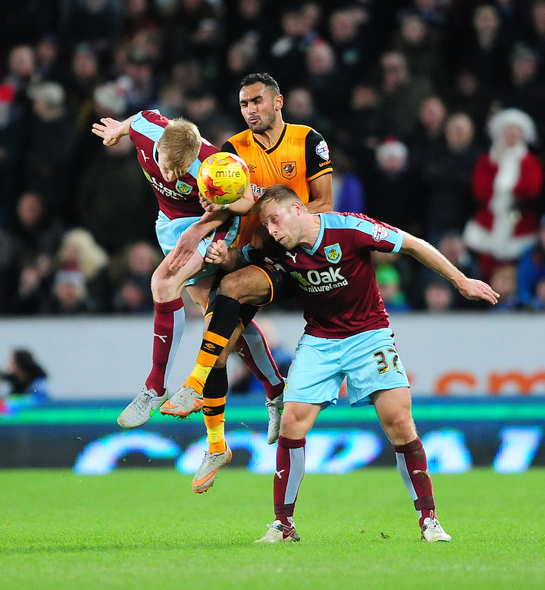 Burnley's Ben Mee, left, with team-mate Scott Arfield vies for possession with Hull City's Ahmed Elmohamady<br /> <br /> Photographer Chris Vaughan/CameraSport<br /> <br /> Football - The Football League Sky Bet Championship - Hull City v Burnley - Saturday 26th December 2015 - Kingston Communications Stadium - Hull<br /> <br /> &copy; CameraSport - 43 Linden Ave. Countesthorpe. Leicester. England. LE8 5PG - Tel: +44 (0) 116 277 4147 - admin@camerasport.com - www.camerasport.com