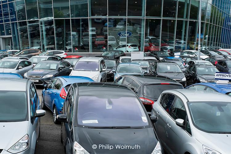 Used cars for sale at a Dagenham Motors showroom in Burnt Oak, London.