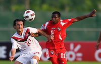 Keven Aleman (10) of Canada fights for the ball with Aldair Paredes (11) of Panama during the semifinals of the CONCACAF Men's Under 17 Championship at Catherine Hall Stadium in Montego Bay, Jamaica. Canada defeated Panama, 1-0.