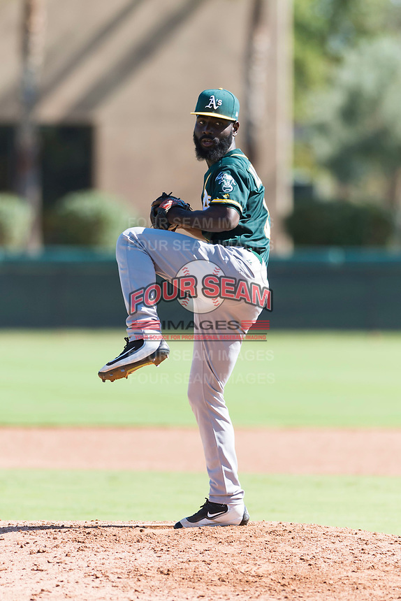 Oakland Athletics relief pitcher Rafael Kelly (61) delivers a pitch during an Instructional League game against the Los Angeles Dodgers at Camelback Ranch on September 27, 2018 in Glendale, Arizona. (Zachary Lucy/Four Seam Images)