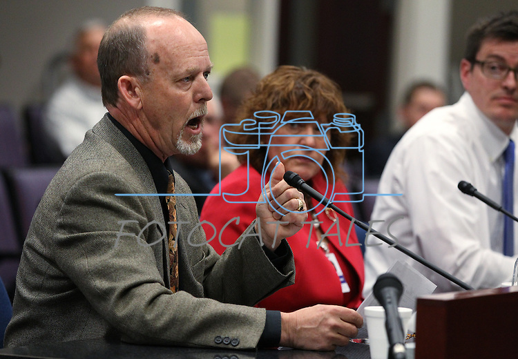 University of Nevada, Reno Professor Grant Cramer testifies at the Legislative Building in Carson City, Nev., on Friday, March 13, 2015. Lobbyist Randi Thompson is at center.<br /> Photo by Cathleen Allison