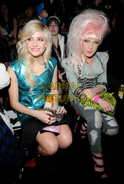 PIXIE LOTT (Victoria Louise Lott)  & JODIE HARSH .At the PPQ Fashion Show during London Fashion Week - Day 2 , BFC Show Space, Somerset House, London, England, UK, February 20th 2010..LFW full length sitting front row blue turquoise dress wig make-up drag queen grey gray ripped denim jeans jacket .CAP/CAN.©Can Nguyen/Capital Pictures