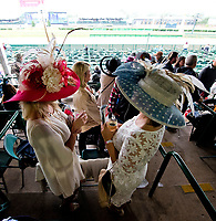 LOUISVILLE, KENTUCKY - MAY 04: Two women drink an Oaks Lily and a Mint Julep while waiting for the storm to pass during Thurby at Churchill Downs on May 4, 2017 in Louisville, Kentucky. (Photo by Scott Serio/Eclipse Sportswire/Getty Images)