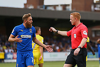 Scott Wagstaff of AFC Wimbledon has words with Referee Alan Young during AFC Wimbledon vs Wycombe Wanderers, Sky Bet EFL League 1 Football at the Cherry Red Records Stadium on 31st August 2019