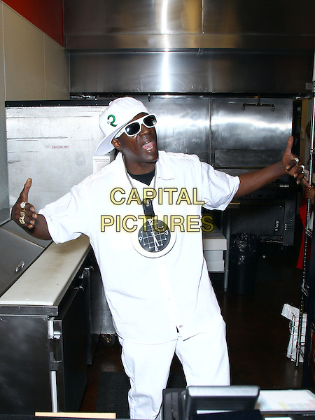 Flavor Flav (William Jonathan Drayton, Jr.).Grand Opening of Flavor Flav's House of Flavor Take Out Restaurant, Las Vegas, Nevada, USA..March 15th, 2012.half length white top sunglasses shades baseball cap hat clock time necklace gold teeth bling hands arms mouth open.CAP/ADM/MJT.© MJT/AdMedia/Capital Pictures.