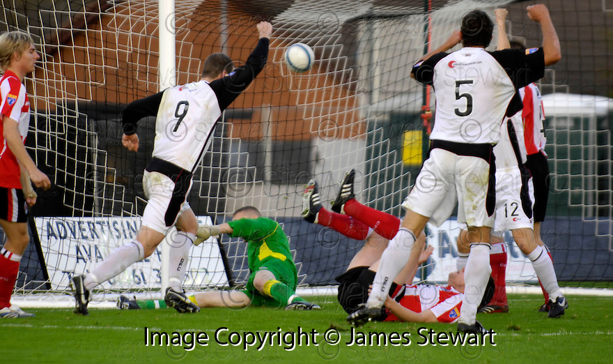 21/10/2006       Copyright Pic: James Stewart.File Name :sct_jspa10_gretna_v_clyde.KENNY DEUCHAR STARTS TO CELEBRATE AFTER THE BALL GOES IN FOR GRETNA'S THIRD... WHETHER IT WAS DEUCHAR OR MCKEOWN GOT THE LAST TOUCH IS UNKNOWN....Payments to :.James Stewart Photo Agency 19 Carronlea Drive, Falkirk. FK2 8DN      Vat Reg No. 607 6932 25.Office     : +44 (0)1324 570906     .Mobile   : +44 (0)7721 416997.Fax         : +44 (0)1324 570906.E-mail  :  jim@jspa.co.uk.If you require further information then contact Jim Stewart on any of the numbers above.........