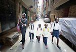 Refugee children whose families came from South Sudan walk to school through a neighborhood of Cairo, Egypt. They attend a school operated by St. Andrew's Refugee Services that is supported by Church World Service.