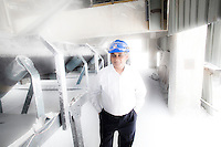 Chief Operating Officer of Vedanta Aluminum Ltd, Dr. Mukesh Kumar, poses for a portrait next to processed alumina at the Vedanta plant in Lanjigarh. The huge bauxite deposits in the Niyamgiri hills have led the Vedanta group to set up an alumina refinery at Lanjigarh, making the local population of Dongria Kondh tribespeople fearful for their future. Vedanta Resources has come under immense pressure from human rights and environmental groups to abandon its plans to mine at the Niyamgiri mountains, as the site is considered sacred by the local tribal community..