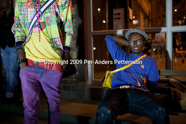JOHANNESBURG, SOUTH AFRICA - APRIL 4:  Young designers wait outside a fashion show at the annual Sanlam fashion week on April 4, 2009, Turbine Hall in central Johannesburg, South Africa. The countries top designers showed their new clothes. (Photo by: Per-Anders Pettersson/Getty Images).