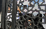 Palestinian women gesture through the gate of Rafah border crossing during a rally calling on Egyptian authorities to open the crossing, in Rafah in the southern Gaza Strip December 22, 2015. Egypt has kept its Rafah crossing largely shut since Cairo's Islamist president was toppled by the army in 2013. Since then, it opened the crossing partially and on a few occasions to allow thousands of Palestinians to travel in and out of the Gaza Strip, border officials said. Photo by Abed Rahim Khatib