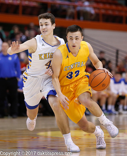 RAPID CITY, SD - MARCH 18, 2017 -- Brandon Kusler #32 of Aberdeen Central drives on Michael Statz #4 of Sioux Falls O'Gorman during the 2017 South Dakota State Class AA Boys Basketball Championship game Saturday at Barnett Arena in Rapid City, S.D.  (Photo by Dick Carlson/Inertia)