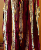 Bands of shining gold and silver ribbon have been sewn onto one of the garments