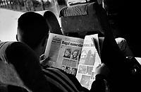 SERBIA, Belgrade-Sarajevo Road, 03/2003..We travell during the state of emergency few days after the murder of Zoran Djindjic. In the bus, six soldiers go back home, reading the newspapers (arrests, new murders). .SERBIE, Route Belgrade-Sarajevo, 03/2003..Photo prise depuis le bus qui relie Belgrade à Sarajevo. Nous voyageons pendant la période d'état d'urgence, quelques jours après le meutre du premier ministre Zoran Djindjic. Dans le bus, six soldats rentrent à la maison, lisant le journal (arrestations, nouveaux meurtres). © Bruno Cogez / Est&Ost Photography.