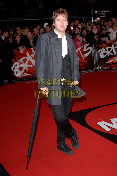 "RICKY WILSON OF KAISER CHEIFS.Arriving at the 2007 ""Brit Awards"" at Earls Court, London, England, 14th February 2007..Full length umbrella.CAP/FIN.©Steve Finn/Capital Pictures."