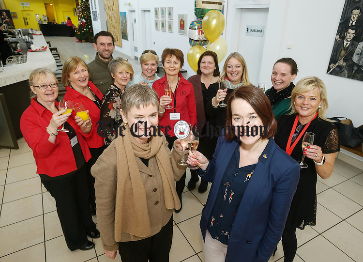 Helen Rackard, chairperson of the board of Glor toasts the 15th anniversary of Glor, Ennis with Orla Flanagan, director watched by staff an board members; <br /> Tina Chandler, Martina Hally, Derek Mc Mahon, Kim Regan Murphy, Brid Walsh O Sullivan Bernie O Loughlin, Margaret O Brien, and Cllr. Mary Howard, board members, Emily O Dwyer and Sharon Mc Inerney. Photograph by John Kelly.