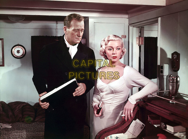 JOHN WAYNE & LANA TURNER.in The Sea Chase (1955) .*Filmstill - Editorial Use Only*.CAP/STF/PEL.Supplied by Capital Pictures.