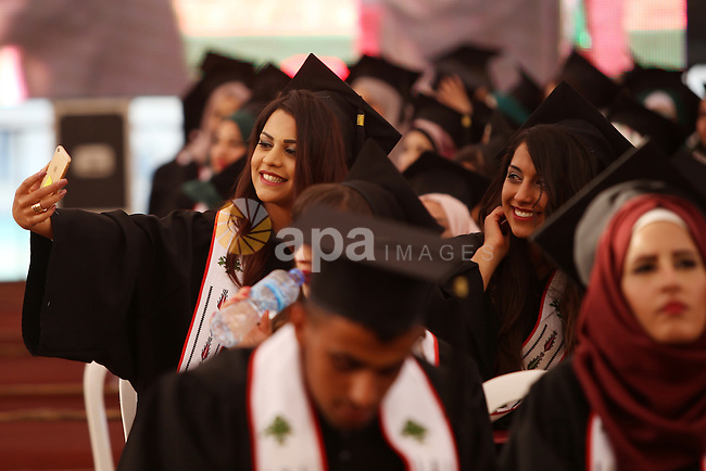 Palestinian students attend their graduation ceremony at the Birzeit University near the West Bank city of Ramallah, June 12, 2015. Photo by Shadi Hatem