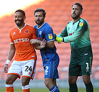 Photographer Stephen White/CameraSport<br /> <br /> The EFL Sky Bet League One - Blackpool v Rochdale - Saturday 6th October 2018 - Bloomfield Road - Blackpool<br /> <br /> World Copyright &copy; 2018 CameraSport. All rights reserved. 43 Linden Ave. Countesthorpe. Leicester. England. LE8 5PG - Tel: +44 (0) 116 277 4147 - admin@camerasport.com - www.camerasport.comBlackpool's Liam Feeney closely marked by Rochdale's Joe Rafferty and goalkeeper Josh Lillis as they jostle for position for a corner kick<br /> <br /> Photographer Stephen White/CameraSport<br /> <br /> The EFL Sky Bet League One - Blackpool v Rochdale - Saturday 6th October 2018 - Bloomfield Road - Blackpool<br /> <br /> World Copyright &copy; 2018 CameraSport. All rights reserved. 43 Linden Ave. Countesthorpe. Leicester. England. LE8 5PG - Tel: +44 (0) 116 277 4147 - admin@camerasport.com - www.camerasport.com