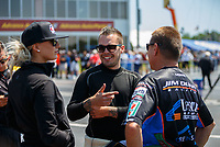 May 6, 2017; Commerce, GA, USA; NHRA funny car driver Jonnie Lindberg (center) talks with top fuel driver Leah Pritchett (left) and funny car driver Jim Campbell during qualifying for the Southern Nationals at Atlanta Dragway. Mandatory Credit: Mark J. Rebilas-USA TODAY Sports