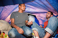 "Quace, left, and Matt inside their improvised umbrella supported shelter as the protest ""Occupy Wall Street"" continues into its third week in Zuccotti Park in New York City on October 6, 2011."