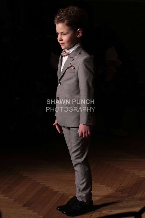 Model walks runway rehearsal in an outfit from the TO Collection by Chayi Scharf , at the Posh Magazine Fashion Carnaval fashion show in WeWork in New York City, on March 19, 2016.