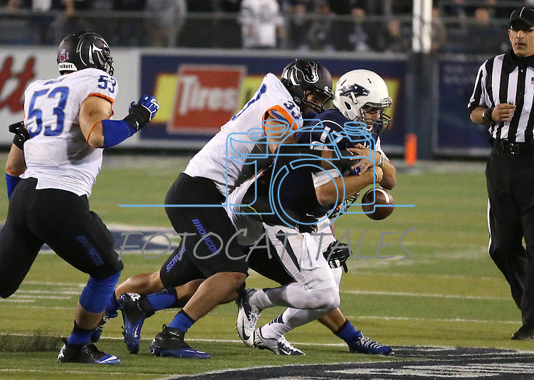 Boise State's Gabe Perez (33) and Kamalei Correa (8, at rear) cause Nevada quarterback Cody Fajardo (17) to fumble during the second half of an NCAA college football game in Reno, Nev., on Saturday, Oct. 4, 2014. Boise State's Beau Martin (53) is at left. Boise State won 51-46. (AP Photo/Cathleen Allison)