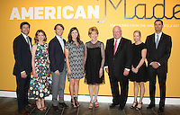 NWA Democrat-Gazette/CARIN SCHOPPMEYER Matt and Mary Kathryn Brown (from left), Carl and Anna George, Robin and Gary George and gather for a photo at the VIP preview of Made in America: Treasures from the American Folk Art Museum. George's Inc. is a co-sponsor of the Crystal Bridges exhibition.