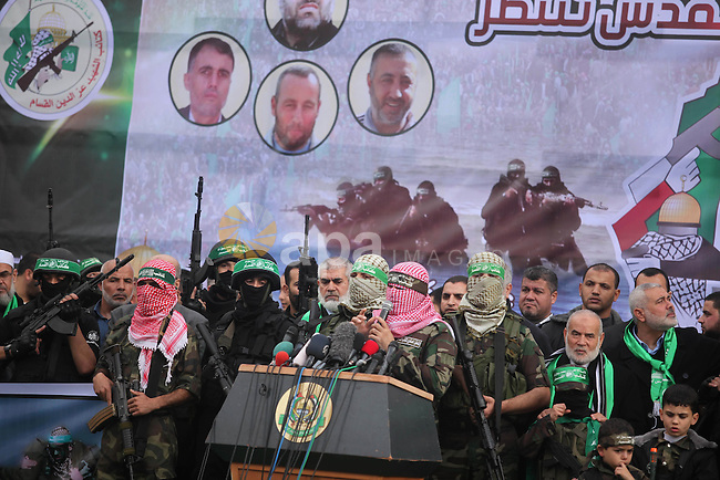 Abu Obaida, the spokesman for the Ezzedine Al-Qassam Brigades, Hamas's armed wing, speaks during rally marking the 27th anniversary of Hamas' founding, in Gaza City December 14, 2014. Photo by Ashraf Amra