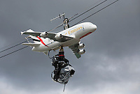 29-05-13, Tennis, France, Paris, Roland Garros,Camers flying over Centercourt connected to a plane