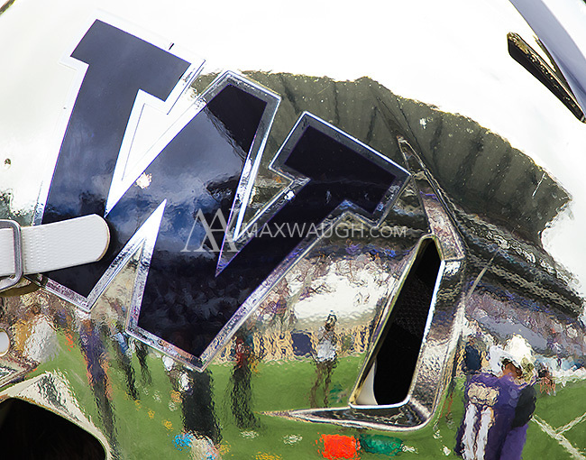 "Husky Stadium is reflected in the Husky ""chrome"" helmet."